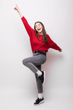 Full Length Portrait Of Happy Young Woman Celebrating Success Isolated Over White Background