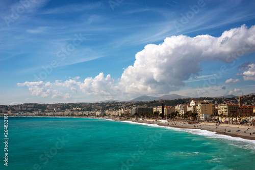 Photo Stands Algeria Nice, France, March 2019. Panorama. Azure sea, waves, English promenade and people resting. Rest and relaxation by the sea. On a sunny warm day, blue waves roll.