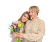 Daughter greeting her mother with flowers on white background