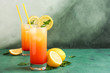 canvas print picture - Glasses of Tequila Sunrise cocktail on table