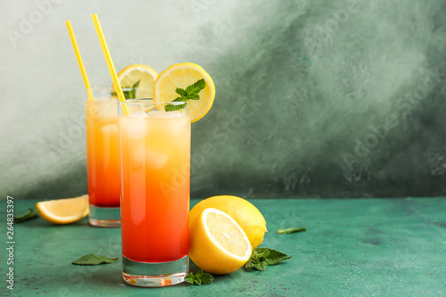 Glasses of Tequila Sunrise cocktail on table Wallpaper Mural