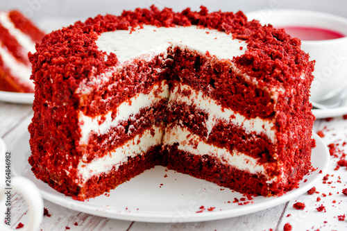 Fotografie, Tablou Red velvet cake, classic three layered cake from red butter sponge cakes with cr