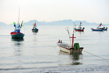Views At The Beach And Small Fishing Boats Parked On The Beach In The Early Morning.