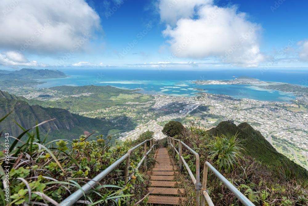 Fototapeta Lush mountain scenes from a ridge trail on Oahu, Hawaii overlooking Kaneohe, Kailua and the windward side of the island