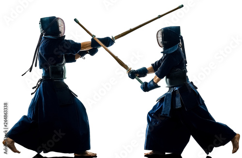 two Kendo martial arts fighters combat fighting in silhouette isolated on white bacground
