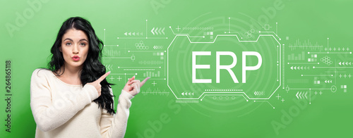 obraz dibond Enterprise resource planning with young woman pointing on a green background