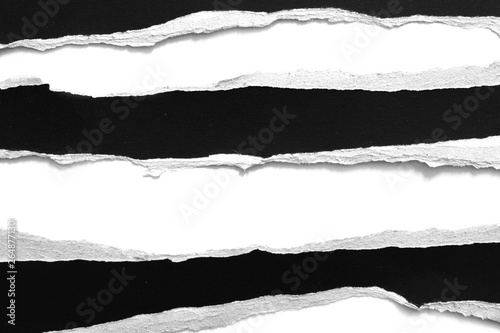 Pinturas sobre lienzo  old torn black paper isolated on white background