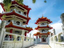 Singapore Nov 26, 2018: The Twin Pagodas On Jurong Lake, A Beautiful Chinese Style Building With Blue Sky In The Chinese Garden With Cloudy Sky In Singapore.