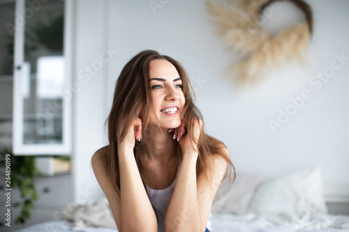 Obraz Beautiful smiling happy woman at home. - fototapety do salonu