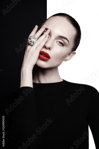 Tuinposter womenART beautiful young woman with big ring pose in studio