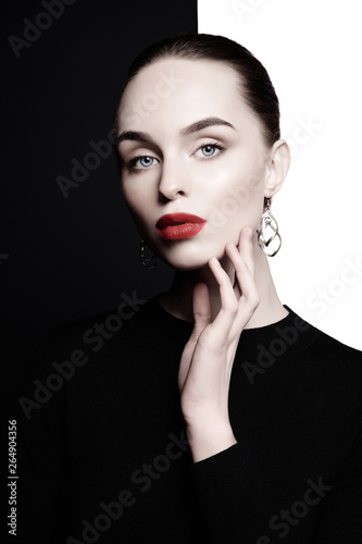Fotobehang womenART beautiful young woman with big earrings pose in studio