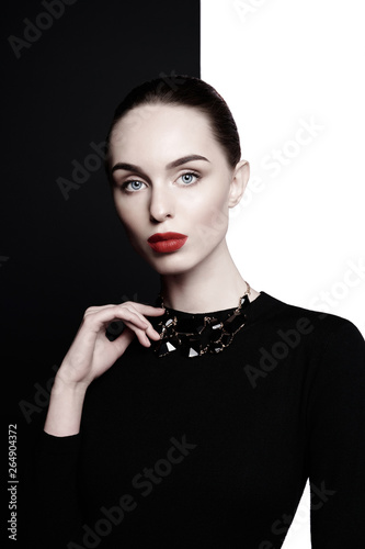 Fotobehang womenART beautiful young woman with black bijouterie pose in studio