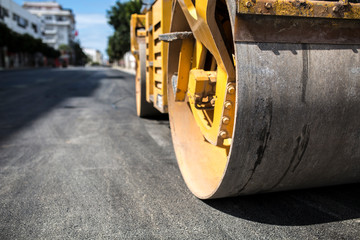 Close view on the road roller working on the new road construction site.