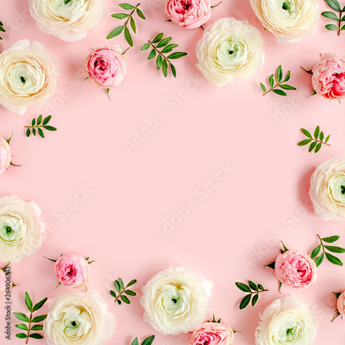 Cadres-photo bureau Fleur Floral background frame made of pink ranunculus and roses flower buds on pink background. Flat lay, top view floral background.