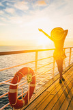 Cruise ship vacation woman enjoying travel vacation at sea. Free carefree happy girl looking at ocean with open arms in freedom pose.