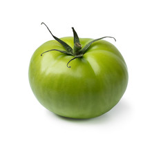 Single Green Unripe Tomato