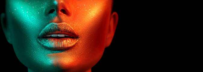 Fashion model woman face in bright sparkles, colorful neon lights, beautiful sexy girl lips. Trendy glowing gold skin make-up. Glitter metallic shine makeup