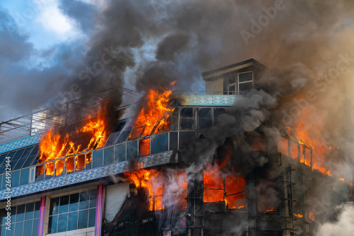 Canvas Prints Fire / Flame Burning building in thick smoke