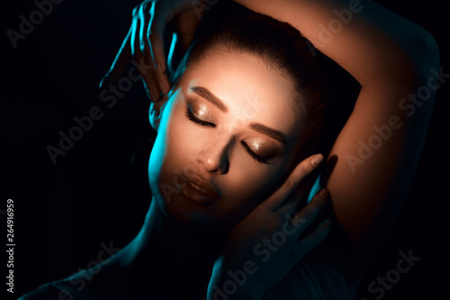 Fotografering  Play Of Light. Sun shining on woman with beautiful makeup