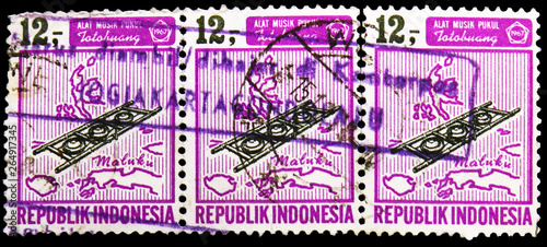 Fotografia  Tree postage stamps printed in Indonesia shows Musical Instruments, serie, circa