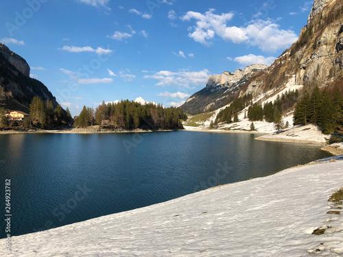 Barrage Alpine lake Seealpsee in the Alpstein mountain range and in the Appenzellerland region - Canton of Appenzell Innerrhoden (AI), Switzerland