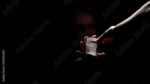 Foto Addicted person sitting in darkness taking dose of narcotic powder, overdose