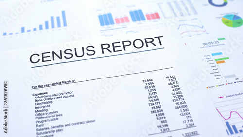Valokuva  Census report lying on table, graphs charts and diagrams, official document