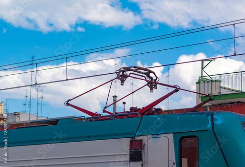 An asymmetrical pantograph connecting the train to the overhead catenary wire Tapéta, Fotótapéta