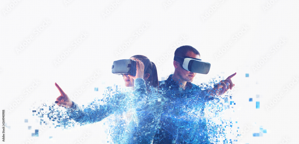 Fototapeta A man and a woman in glasses of virtual reality. The concept of modern technologies and technologies of the future. Fragmented by pixels. VR glasses.
