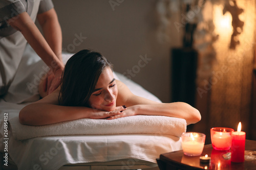 Poster Spa Spa, massage. Young dark-haired beautiful girl doing massage.
