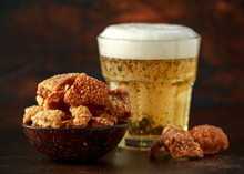 Crispy Pork Scratchings With Cold Beer In Bowl