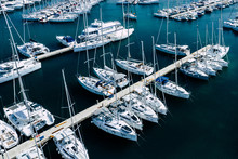 Aerial View Of A Lot Of White Boats And Yachts Moored In Marina. Photo Made By Drone From Above.