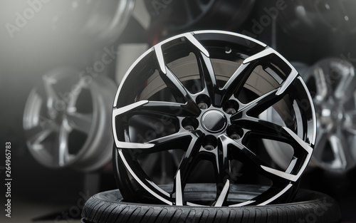 Tablou Canvas beautiful alloy wheels dark background, close up.