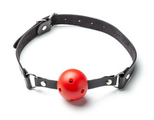 Red Ball Gag In Mouth Isolated On White Background. Intimate Toys. Sex Abuse Slavery