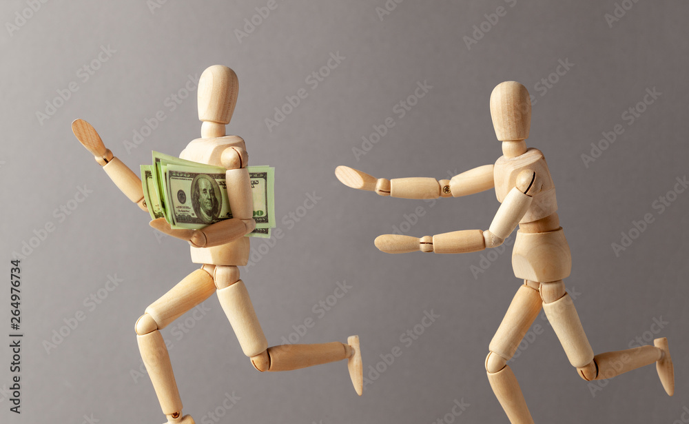 Fototapeta Stealing money. The thief with money runs away from the person