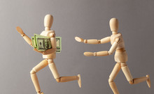 Stealing Money. The Thief With Money Runs Away From The Person