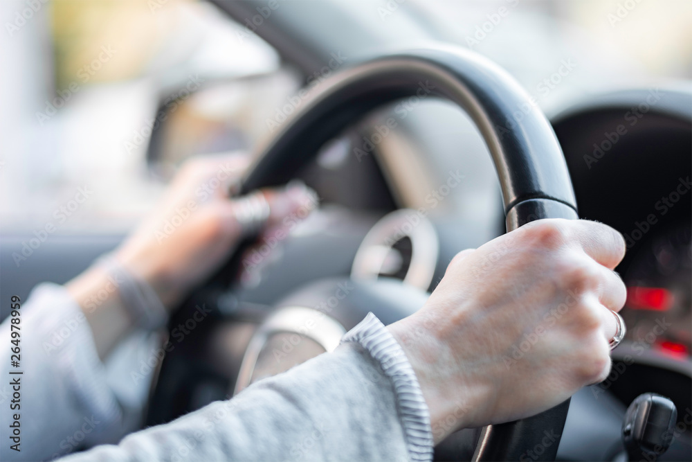 Fototapety, obrazy: Close up of hands on steering wheel shallow dof