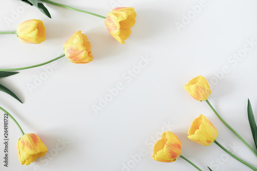Printed kitchen splashbacks Floral Beautiful composition of spring flowers. Yellow tulips flowers on white background. Valentine's Day, Easter, Birthday, Happy Women's Day, Mother's Day. Flat lay, top view, copy space