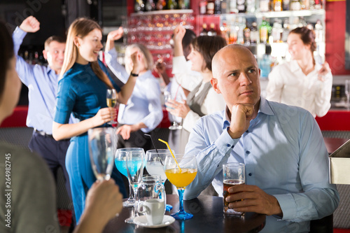 Stampa su Tela  Worried businessman at corporate party