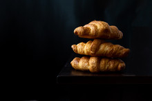 Close Up Of Fresh Baked Croissant On Wood Table With Coffee Mug And  News Paper On Relaxing Morning At Home, Bread And Coffee, Breakfast Healthy Food Of The City Life