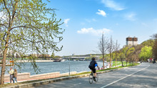 Moscow City Russia Park On Moskva River Embankment Street Panorama View Of Modern Town Road With Bike Lane Person Riding Bicycle People Walking On Sunny Spring Day Outdoor Activity 4K UHD Landscape