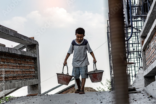Cuadros en Lienzo Children working at construction site for world day against child labour concept