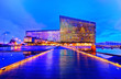 Leinwanddruck Bild - View of the Harpa Music Hall and Conference Centre with beautiful lights at night in Reykjavik, Iceland.