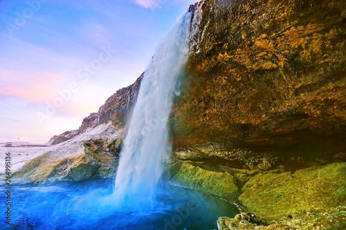 Wall Murals Waterfalls View of Seljalandsfoss waterfall at dawn in winter in Iceland.