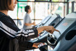 Young people running in machine treadmill at fitness gym club..Young sporty man and woman training in modern gym