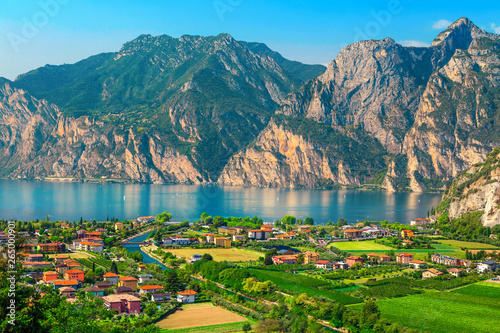 Fotografia Fantastic Torbole cityscape with plantations and lake Garda, Italy, Europe