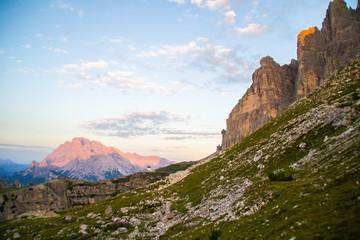 Beautiful panorama view of Cappella degli Alpini chapel in Tre Cime di lavaredo National Park. Idyllic sunrise landscape scene in Dolomites, Tirol Alps, Italy