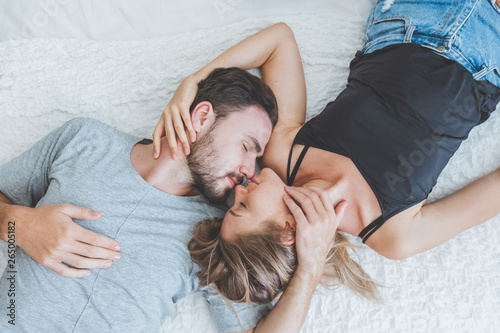 Obraz na plátně  Happy couple lover on bed, hug and kiss in romantic time, love and passionate concept