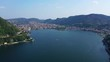 Aerial drone video of famous beautiful village of Como in lake Como one of the deepest in Europe, Lombardy, Italy