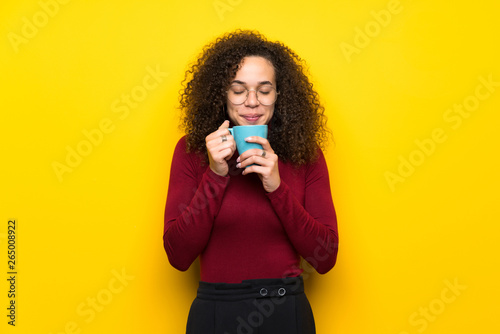 Foto auf Leinwand Schokolade Dominican woman with turtleneck sweater holding a hot cup of coffee